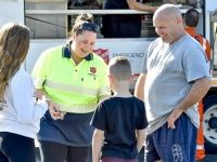 Father and his kids chatting to a Salvos Emergency volunteer