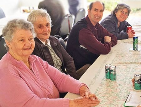 friends enjoy a community meal