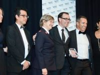 Salvos Legal team accepting an award for excellence