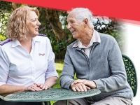A Salvation Army Aged Care Plus worker talks with a senior gentleman