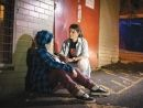 A Salvo speaking with a woman experiencing homelessness
