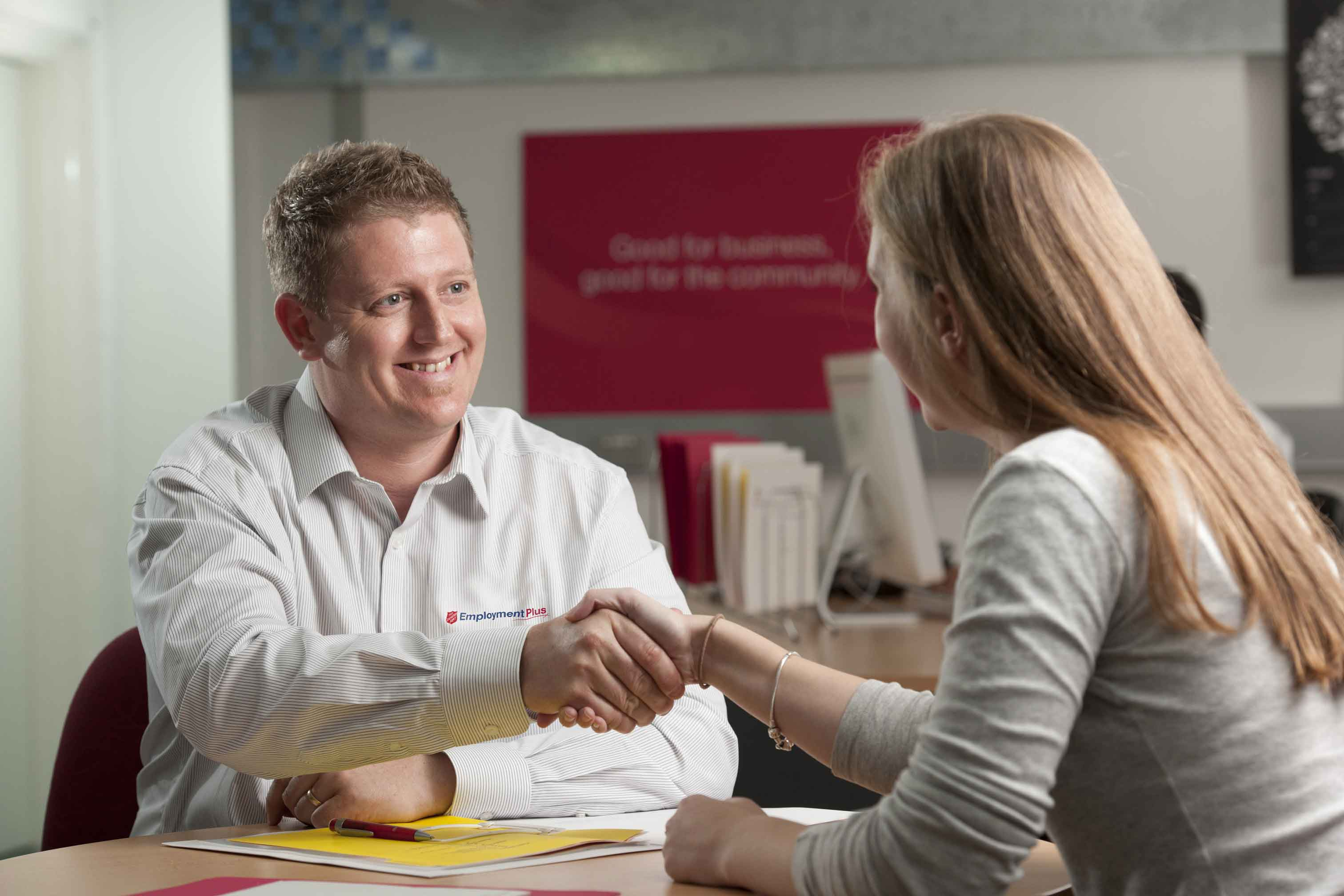 Man from Employment Plus shaking hands with female job seeker
