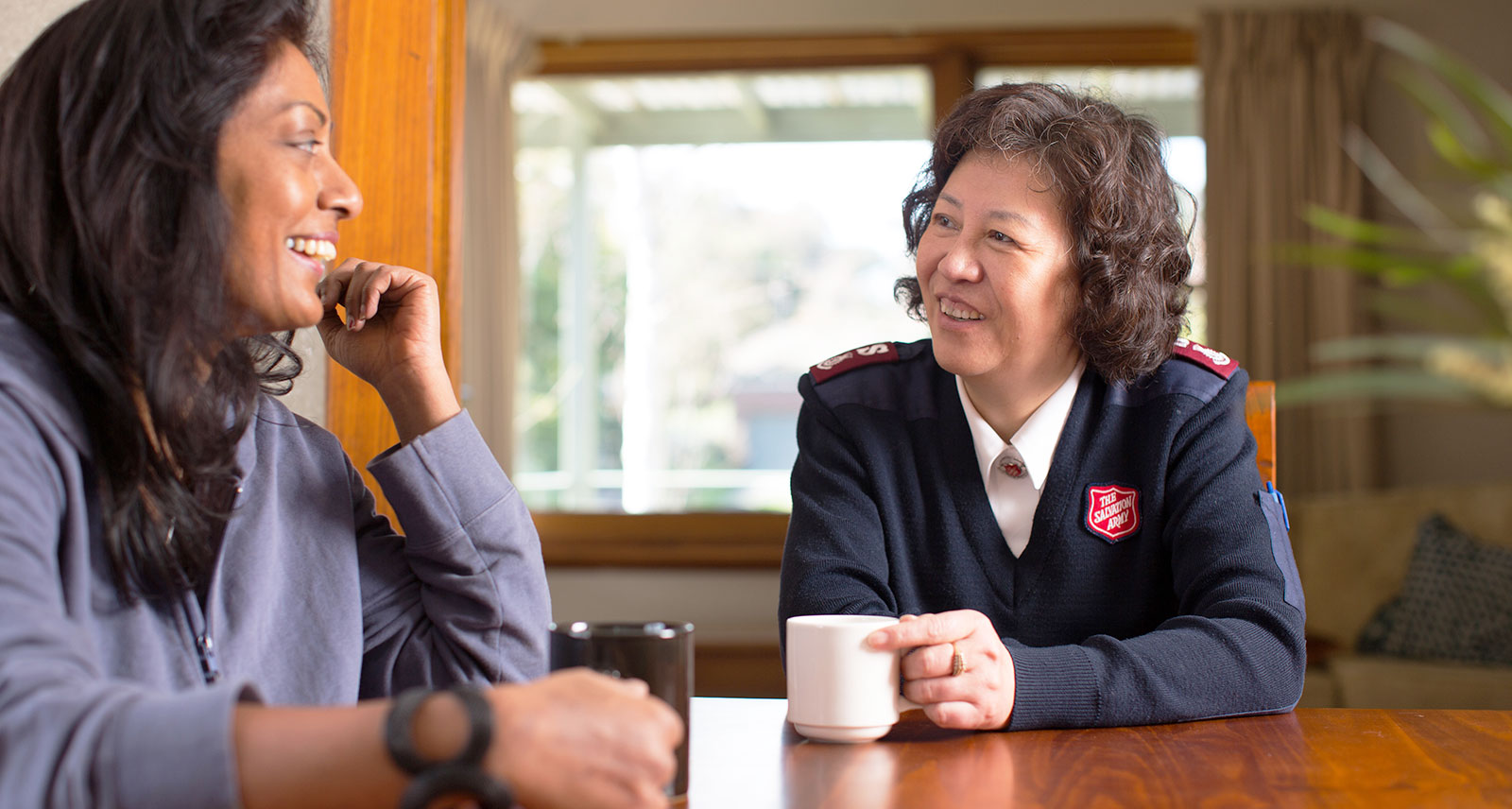 Salvation Army Officer listening to a client