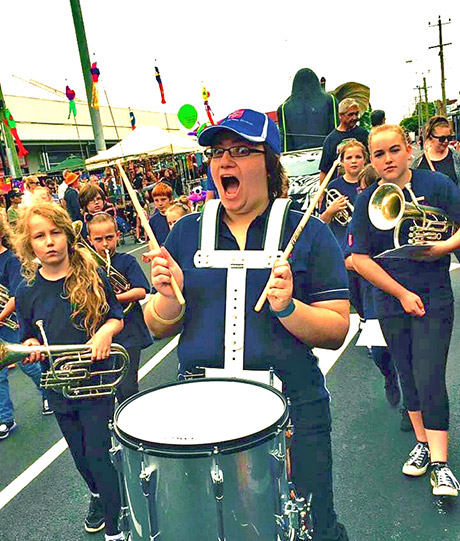 Britteny leads the march with drums