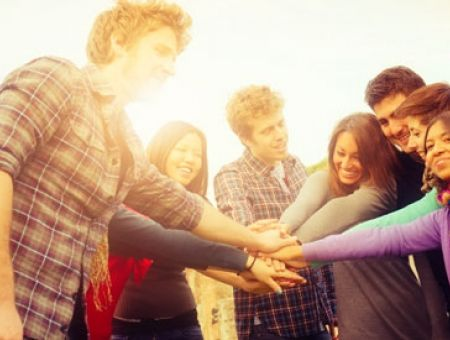 image of young people hands together