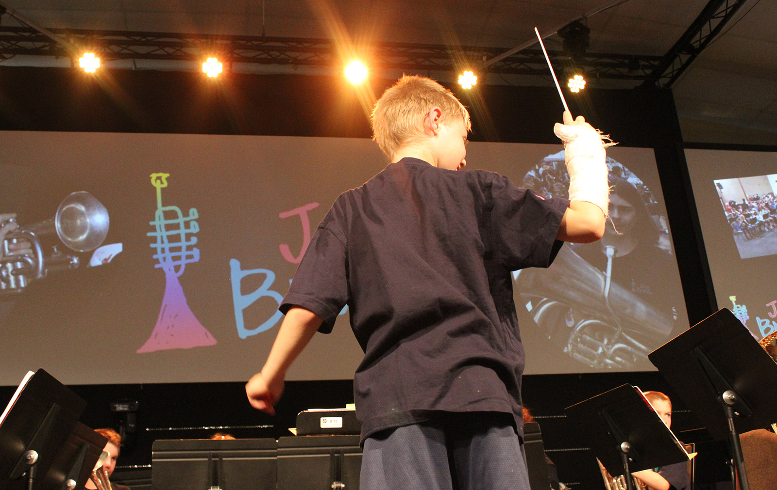 young boy conducting