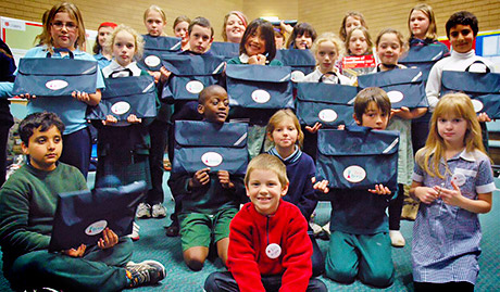 children happy to recieve music satchels