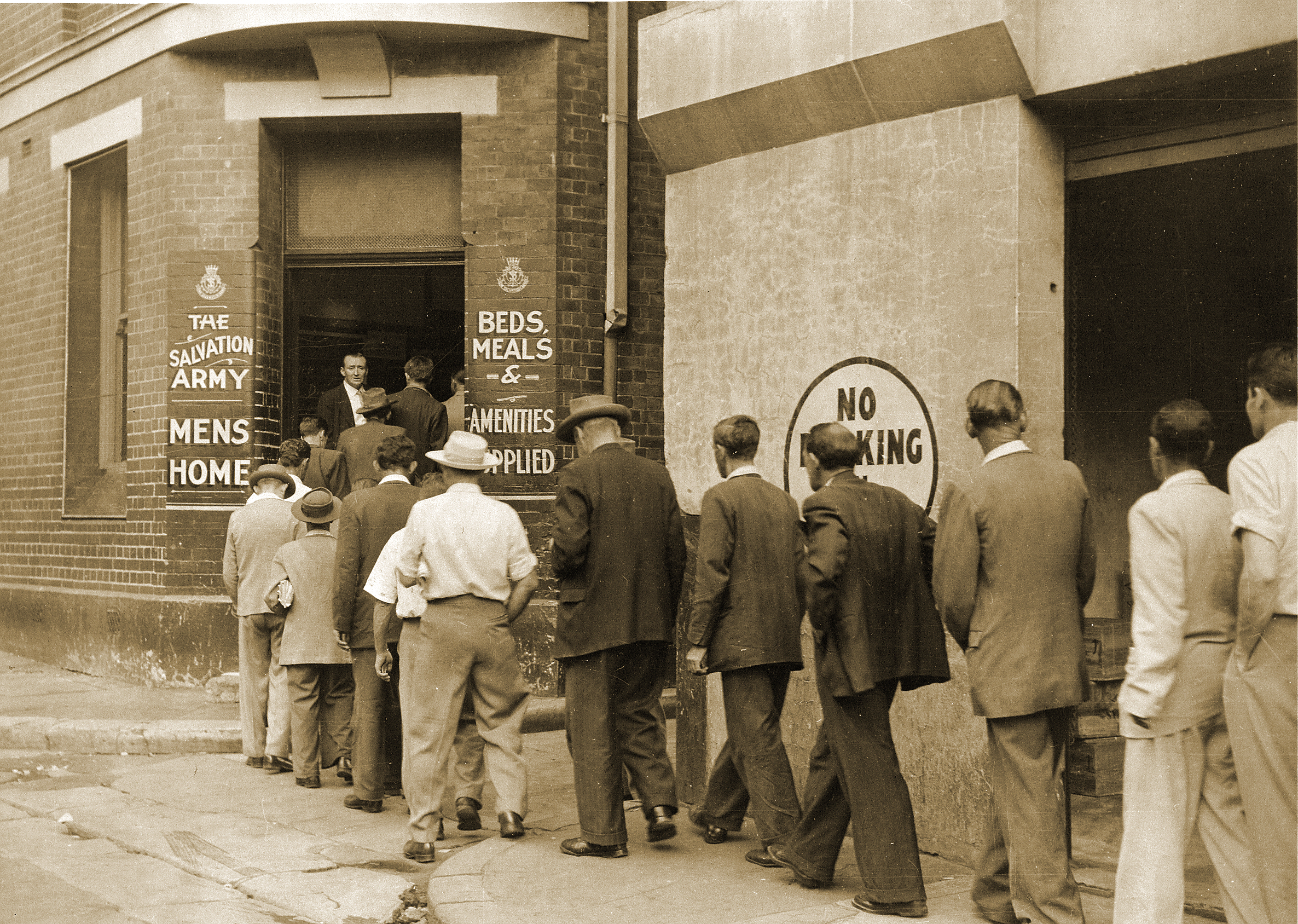 Men line up outside The Salvation Army's Foster House